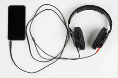 Smart phone with headphones Stock Images