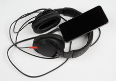 Smart phone and headphones Royalty Free Stock Photo