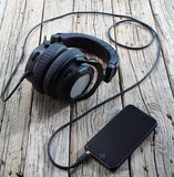 Smart phone with headphones Royalty Free Stock Photo