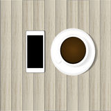 Smart phone and hot coffee Royalty Free Stock Photos