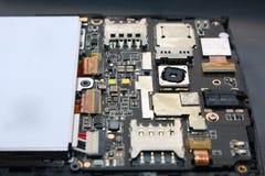 Smart Phone Internal Hardware. Photo image. Close up of smart phone internal hardware. Cellphone repair process illustration Stock Photos
