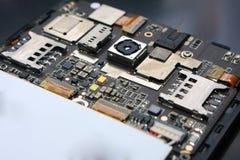 Smart Phone Internal Hardware. Photo image. Close up of smart phone internal hardware. Cellphone repair process illustration Stock Image