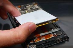 Smart Phone Internal Hardware. Photo image. Close up of smart phone internal hardware. Cellphone repair process illustration Royalty Free Stock Image