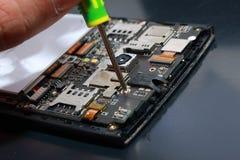 Smart Phone Internal Hardware. Photo image. Close up of smart phone internal hardware. Cellphone repair process illustration Royalty Free Stock Photo