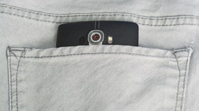 Smart phone in a jean back pocket Royalty Free Stock Images