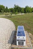 Smart Bench in the city park of a modern town of Tiszaujvaros in Hungary stock photography