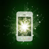 Smart phone with magic light and falling stars Stock Photography