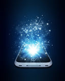 Smart phone with magic light and falling stars Royalty Free Stock Images