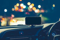 Smart phone on magnet car mount phone holder Gps Royalty Free Stock Photo