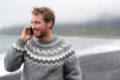Smart phone man talking on phone on beach, Iceland Royalty Free Stock Photo