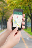 Smart phone with map gps navigation application on the screen Royalty Free Stock Photo