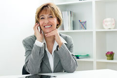 Smart phone mature businesswoman Stock Image