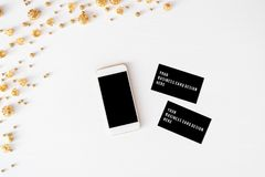 Smart phone mobile business cards christmas composition. wallpaper, decorations, ornaments on white background. Flat lay. stock images