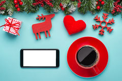Smart phone mock up with rustic Christmas decorations for app presentation. View from above Stock Photo