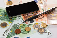 Smart phone and money Royalty Free Stock Photos