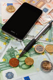 Smart phone and money Stock Images