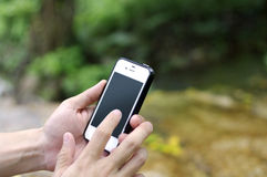 Smart phone in nature Stock Image