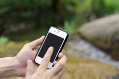 Smart phone in nature Stock Photos