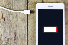 Smart phone need to charge battery Royalty Free Stock Photography