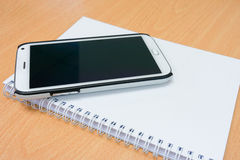 Smart phone and notebook Stock Photography