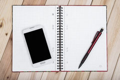 Smart Phone, Notebook On Desk Stock Images