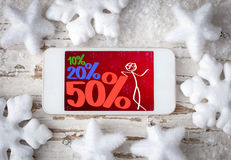 Smart phone with  notification for Christmas discounts Royalty Free Stock Photos