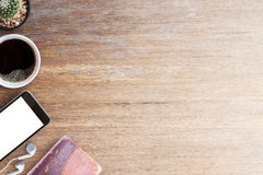 Smart phone and old notebooks with cup of coffee on wood table Stock Images