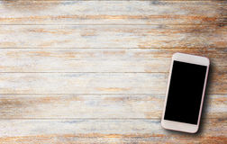 Smart phone on old wooden table stock images