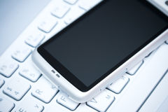 Free Smart Phone On Laptop Royalty Free Stock Photos - 22455598