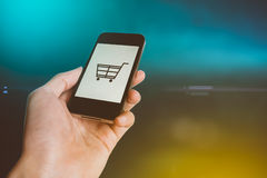 Smart phone online shopping in Human hand. Mobile business and modern lifestyle concept Stock Photography