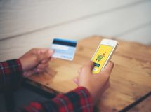 Smart phone online shopping in woman hand and credit card. Buy s. Tuff with e commerce website stock image