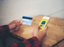 Smart phone online shopping in woman hand and credit card. Buy s. Tuff with e commerce website royalty free stock image