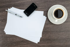 Smart Phone, paper and drawing pen with coffee Royalty Free Stock Photography