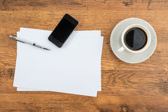 Smart Phone, paper and drawing pen with coffee Royalty Free Stock Images