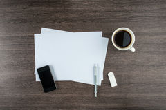 Smart Phone, paper, Eraser and Mechanical pencil with coffee Royalty Free Stock Images