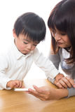 Smart phone and parent and child Stock Photo