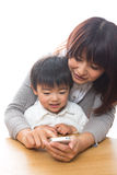 Smart phone and parent and child Royalty Free Stock Image