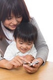 Smart phone and parent and child Stock Images