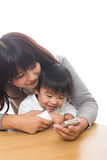 Smart phone and parent and child. Parent and child who play with a smart phone Royalty Free Stock Image