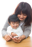 Smart phone and parent and child. Parent and child who play with a smart phone Royalty Free Stock Photos