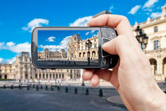 Smart phone in paris Stock Photo