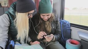 Smart phone people sharing and watching funny video laughing while traveling in train on commute. stock footage