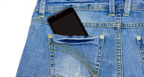 Smart phone is in the pocket of blue jeans Stock Photos