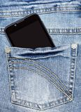 Smart phone is in the pocket of blue jeans Stock Image