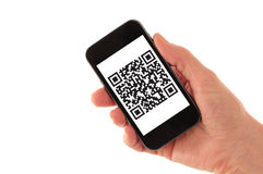 Smart Phone with QR Code (fictitious). Hand Holding Smart Phone with QR Code Barcode (QR Code is fictitious – created by photographer) isolated on white Stock Photos