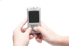 Smart phone with qwerty keyboard in hand. Isolated on white background royalty free stock photography