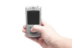 Smart phone with qwerty keyboard in hand. Isolated on white background Stock Photography