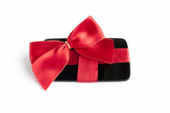 Smart Phone with Red Ribbon and Bow isolated Royalty Free Stock Images