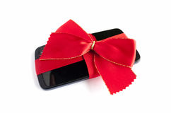 Smart Phone with Red Ribbon and Bow isolated Stock Photo