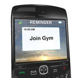 Smart phone reminder to join gym Royalty Free Stock Photography